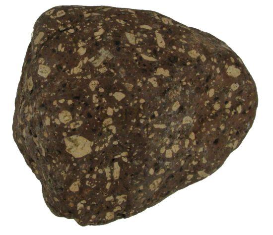 Porfir z północnej Polski, przyniesiony przez lądolód, wiek skały: mezoproterozoik.